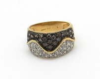 18 kts gold ring with two-color stones
