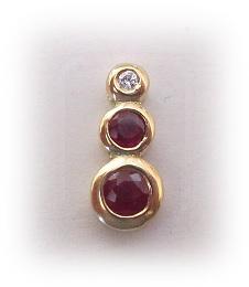 Colgante Rubies y Brillante en Oro 1ª Ley