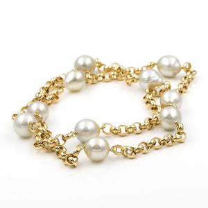 Collar bicolor realizado en oro amarillo  y oro blanco de 750 milésimas (18kt) con cadena de eslabones oval e intercalando con perlas south sea pearls (australianas)