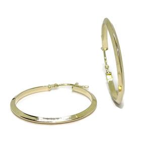 Pendientes Aros de oro amarillo de 18k acabados en canto de 2mm de ancho por 2.70cm de diámetro exterior.  Never say never