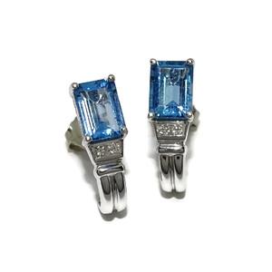 Pendientes de 0.05cts de diamantes y topacio azul. presión Never say never