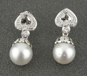 Pendientes de oro blanco de 18 kt con diamantes talla brillantes de 0,40 kts y Perla South Sea Pearl (Australiana) de 10,45mm DSC-VJR74-B