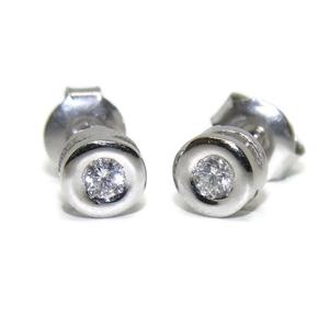 Pendientes de 0.24 cts de diamantes y oro blanco de 18Ktes. 0.8cm. presion Never say never