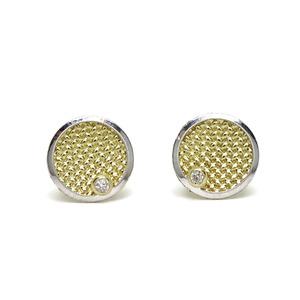 Pendientes de oro bicolor de 18k con forma de círculo con circonita oro amarillo. cierre presión Never say never