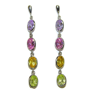 Pendientes largos de oro blanco de 18Ktes y circonitas de color Never say never