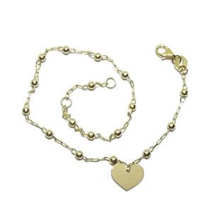 Tobillera de oro amarillo de 18k con cadena de eslabones y bolitas de 3mm con motivo de corazón.  Never say never