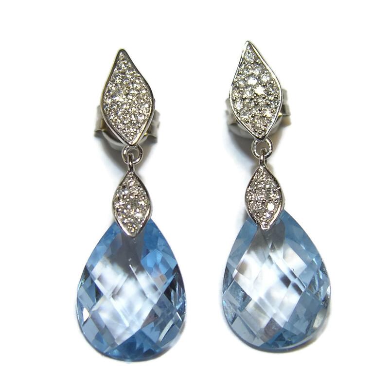 104c51d9e34a Pendientes con 0.35cts de diamantes y topacios azules en oro blanco de  18ktes 2.8cm. Cargando zoom