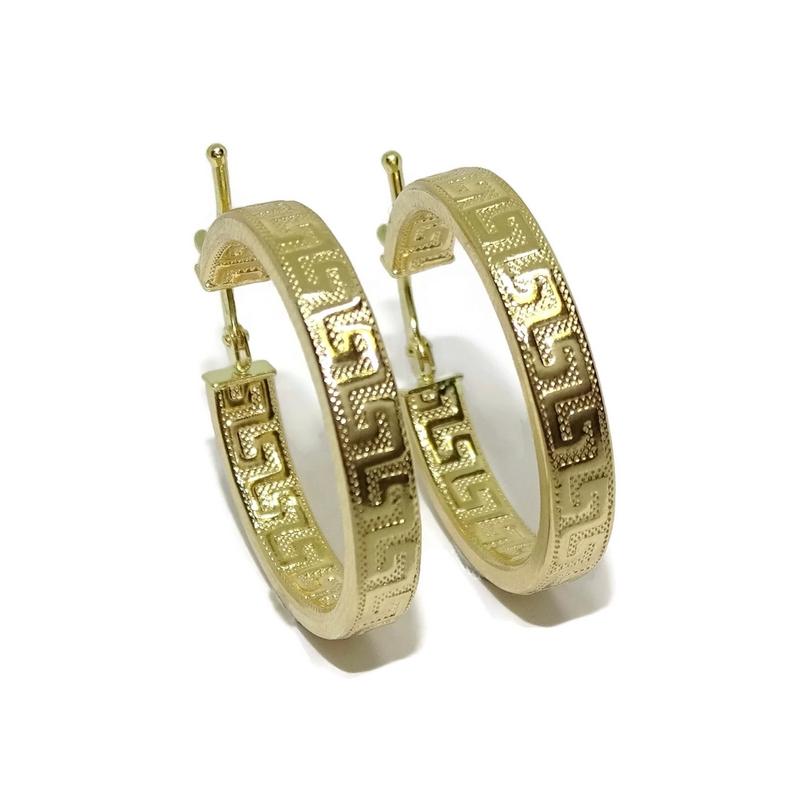 4a86e3a18fdf Pendientes de aro de oro amarillo de 18k con greca