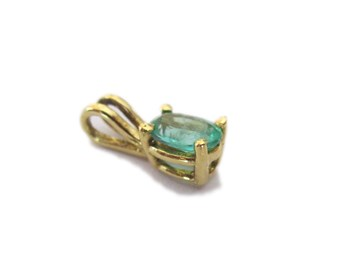 Emerald pendant gold 1st law