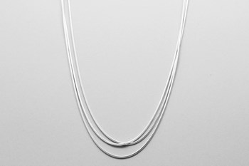 WOMEN\'S NECKLACE MADE WITH A DESIGN OF THREE CHAINS STERLING SILVER.