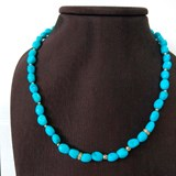 NECKLACE TURQUOISE SASSI FINE WITH ENTREPIEZAS 0.08 KT DIAMONDS IN GOLD AMARILLO18 KT.CRESBER