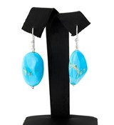 PAIR OF EARRINGS MADE IN STERLING SILVER WITH TURQUOISE IRREGULAR.�