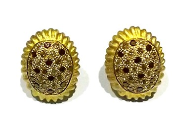 Gold and brilliant earrings
