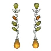 SPECTACULAR DANGLING EARRINGS IN WHITE GOLD WITH 0,38 CT BRIGHT, CITRINES AND OLIVINAS. CRESBER