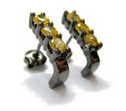 Silver earrings and yellow stones