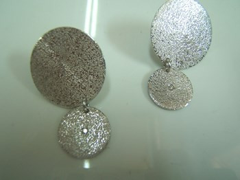 Silver and diamond earrings.