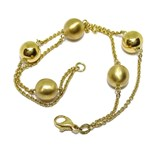 BEAUTIFUL BRACELET WITH 5 GOLDEN BALLS OF 10MM, 2 OF WHICH ARE ALL BRIGHTNESS AND 3 OF THEM MATE NEVER SAY NEVER