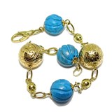 BRACELET OF 18K GOLD WITH 3 TURQUOISE 1.20 CM DI�METRO, 2 BIG BALLS OF 18K GOLD ENGRAVED NEVER SAY NEVER