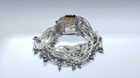 BRACELET MADE OF STRIPS OF SILVER WOVEN WITH A BATH OF RHODIUM, AND HEMATITE FACETTED PESAVENTO