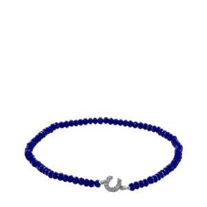 Pulsera elástica azul con herradura de plata de ley