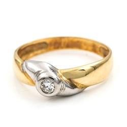 Sortija bicolor realizada en oro blanco y amarillo de 750 milésimas (18kt) con un diamante central talla de brillante de 0,15 kts en total, talla de la sortija 15