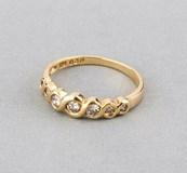 RING OF YELLOW GOLD WITH 7 DIAMONDS SIZE BRIGHT 0,30 KTS TOTAL SIZE OF THE RING 14 (IS)